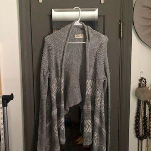 Gray and white cardigan sweater